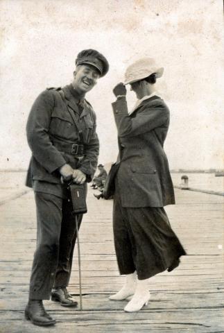 Sepia photograph of Chamberlain and female companion.