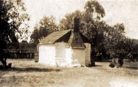 Sepia photograph of a small shack.