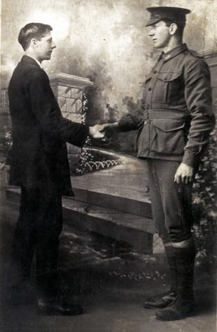 Black and white photo of William and Thomas shaking hands.