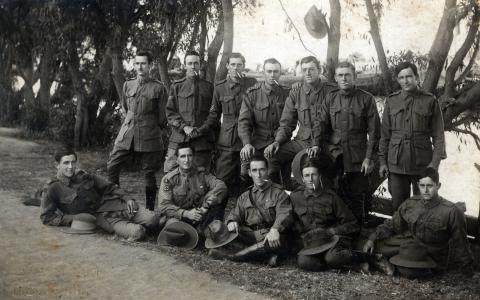 Black and white photo of Thomas Irwin and friends in uniform