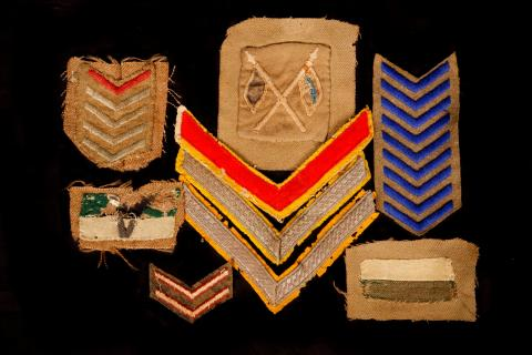 Picture of stripes and badges displayed.