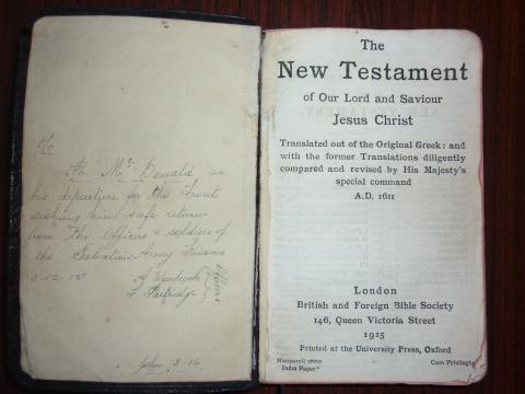 Photograph of Richard McDonald's bible with a written dedication.