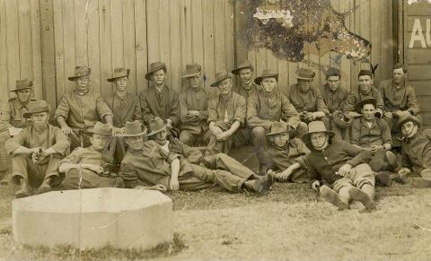 Sepia photograph of soliders in uniform featuring Henry Edward O'Neill.