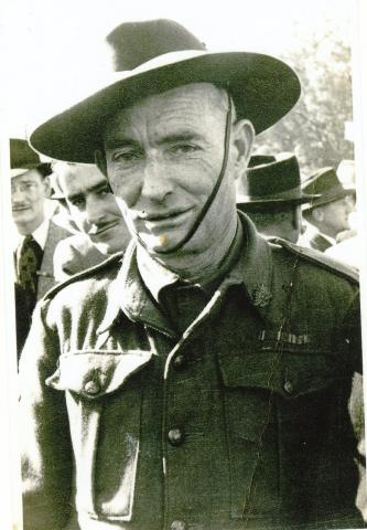 Sepia photograph of William George outdoors in uniform.
