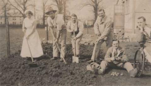 Eddie Stewart sepia photograph with friends