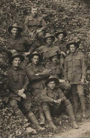 Eddie Stewart sepia photograph with comrades.