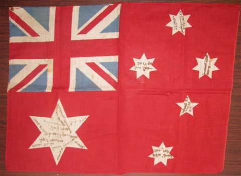 Australian red ensign flag signed