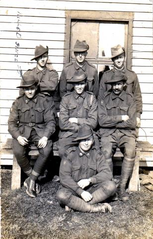 Black and white photo of six men in uniform with David Morgans