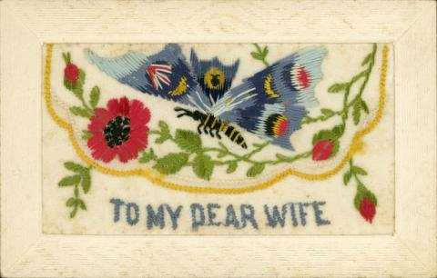 Postcard with embroidered flowers. Inscription reads: To My Dear Wife