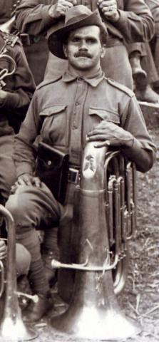 Richard McDonald posing with a tuba