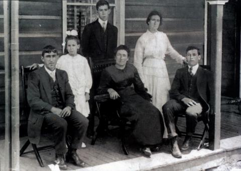 Six people posing for a photograph.