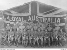 Black and white photo of army officers in front of Union Jack.