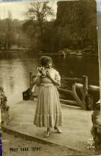 Sepia photo of woman with flowers.