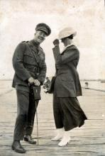 Sepia photograph of Chamberlain and female companion.