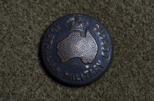 Image depicts medal that says 'Australian Military Forces' with a map of Australia in the middle.