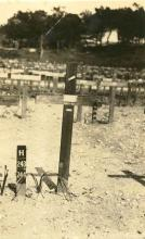 Grave shown as a single wooden post.