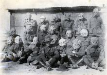 Black and white photo of soldiers in gas masks, featuring Thomas Kennedy Irwin Jr