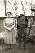 Sepia photograph of a man in woman, the man in uniform.