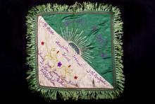 Embroidered fabric banner belonging to Francis Henry Pugh.