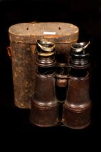 Picture of field glasses with its case.