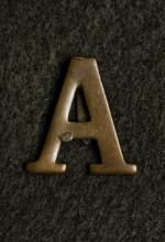 Image depicts a picture of the Anzac badge.