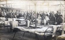 Black and white photo of soldiers in a hospital ward.