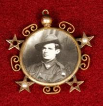 Medal featuring a black and white portrait of Edwin Street in uniform.