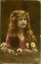 Postcard from Judy to Annie. Front depicts a portrait of a woman with flowers in her hair.