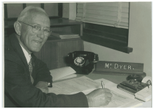 Black and white photograph of Martin Dyer writing.
