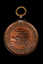 Image depicts bronze medallion with the inscription 'The Royal Life Saving Society established 1891'