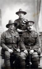 Black and white portrait of three soldiers in uniform